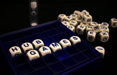 Cubes With Letters Spelling Out HUB Games