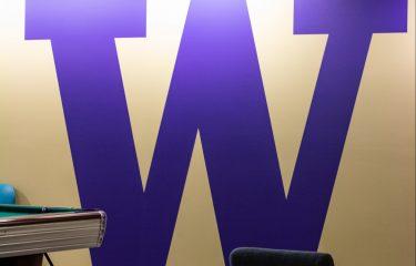 Purple W Painting Inside HUB Games