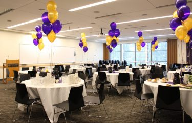 HUB Room Filled with Tables and Balloons