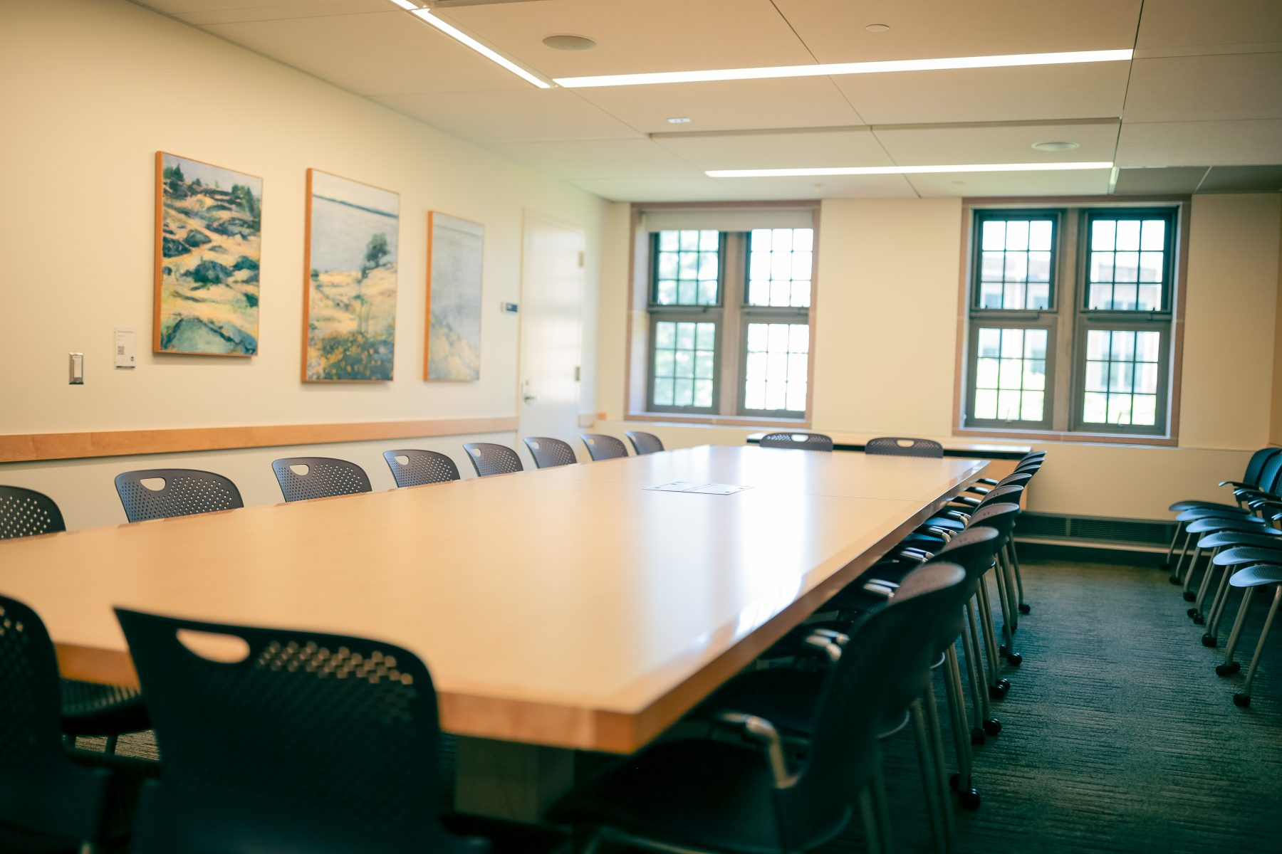 This conference room features art on the South wall