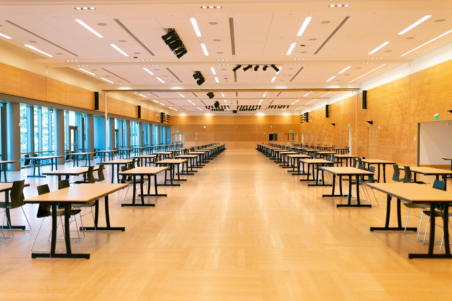 The maximum exhibit set in Both Ballrooms can accommodate 143 tables
