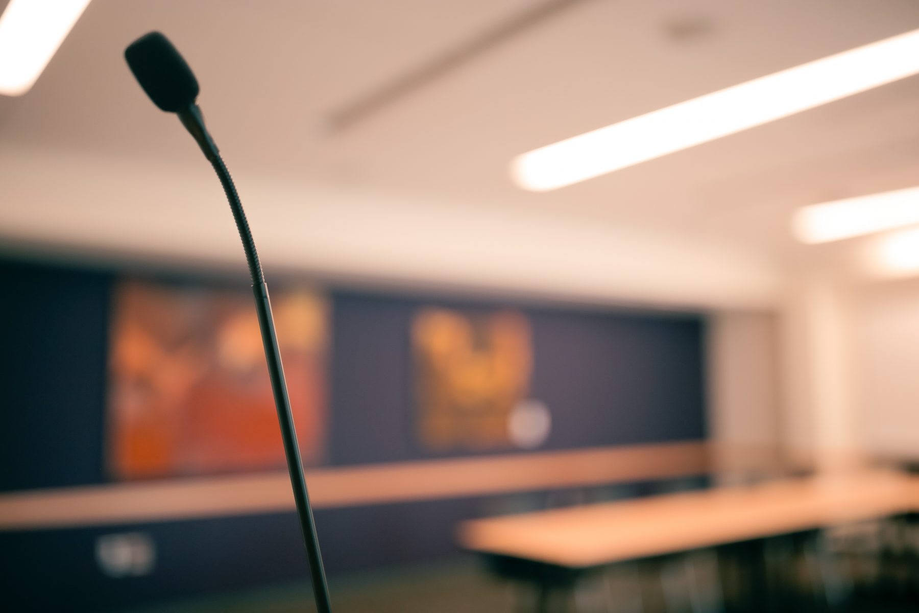 A microphone is installed on the lectern and is ready for use