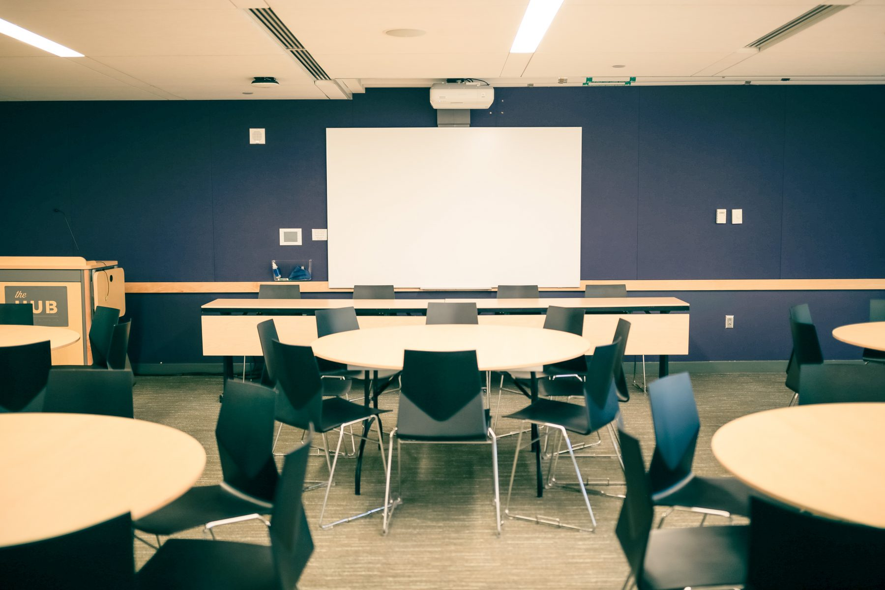 An installed projector and whiteboard are included with rental